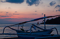 Boats on the beach just before dawn in Amed, Bali, Indonesia