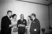 05/05/1965<br /> 05/05/1965<br /> 05 May 1965<br /> Ballsbridge Motors Ltd. Wholesale Division, reception at the Intercontinental Hotel Dublin. Chatting at the reception were (l-r): Mr. T.C. Andrews, General Manager, Wholesale Division, Ballsbridge Motors Ltd., Dublin; Mrs Stephen O'Flaherty; Mr. Allen Zane, Daimler-Benz, Stuttgard; Mrs T.C. Andrews and Mr. Stephen O'Flaherty, Chairman, Motor Manufacturers Ltd., Dublin.
