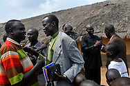 Church goers greet each other after a Sunday service in a neighborhood church.<br /> Yei, South Sudan. 26/06/2011.