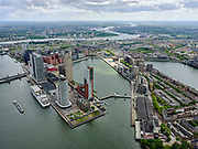 Nederland, Zuid-Holland, Rotterdam, 14-05-2020; Rotterdam-Zuid met zicht op Kop van Zuid, Hotel New York, Rijnhavenbrug. Rechts Katendrecht (De Kaap) met de Fenix-loodsen (voorheen Fenix Food Factory - toekomstig Landverhuizersmuseum). Nieuwe Maas verdwijnt in de verte.<br /> Rotterdam South with Katendrecht with  Fenix warehouses (formerly Fenix Food Factory - future Land Mover Museum). <br /> View of Kop van Zuid, Hotel New York, Rijnhavenbrug.<br /> <br /> luchtfoto (toeslag op standard tarieven);<br /> aerial photo (additional fee required)<br /> copyright © 2020 foto/photo Siebe Swart