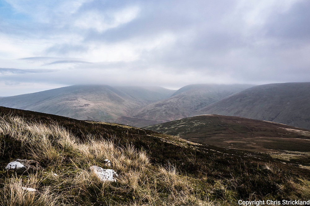 Looking south east towards Winterhope Burn and Megget Reservoir from Broad Law in the South of Scotland.