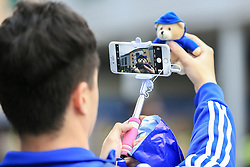 Chelsea fans takes a photo of his Chelsea bear with Stamford Bridge in the background - Mandatory by-line: Jason Brown/JMP - 15/10/2016 - FOOTBALL - Stamford Bridge - London, England - Chelsea v Leicester City - Premier League