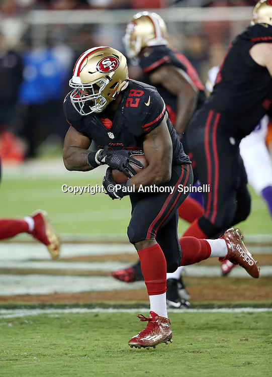 San Francisco 49ers running back Carlos Hyde (28) runs for a fourth quarter first down during the 2015 NFL week 1 regular season football game against the Minnesota Vikings on Monday, Sept. 14, 2015 in Santa Clara, Calif. The 49ers won the game 20-3. (©Paul Anthony Spinelli)