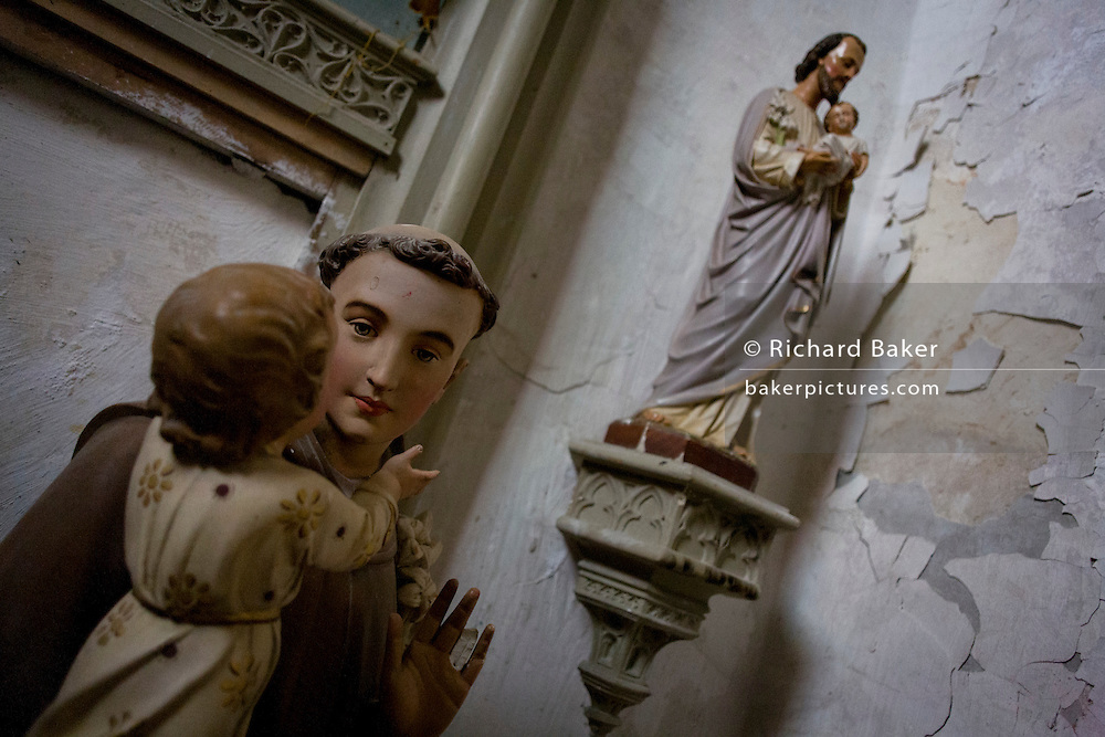 Plaster Catholic idols in a corner of the church at Le Grand-Pressigny, Indre-et-Loire, France.