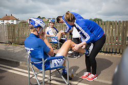 Iris Slappendel (NED) (left) and Katie Hall (USA) (middle) of UnitedHealthcare Cycling Team receive a quick legrub before the start of the Aviva Women's Tour 2016 - Stage 1. A 138.5 km road race from Southwold to Norwich, UK on June 15th 2016.