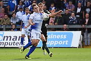 Sam Matthews (26) of Bristol Rovers on the attack tracked by Scott Wootton (25) of Plymouth Argyle during the EFL Sky Bet League 1 match between Bristol Rovers and Plymouth Argyle at the Memorial Stadium, Bristol, England on 8 September 2018.