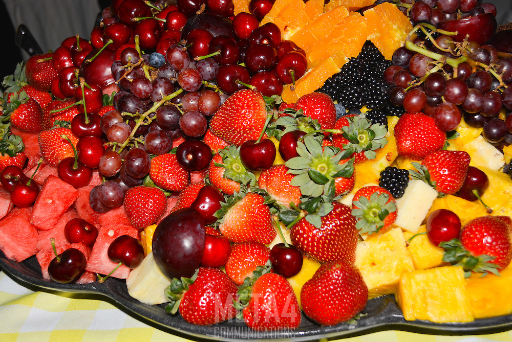 Strawberries, grapes, oranges and pineapples make a visually appealing appetizer.