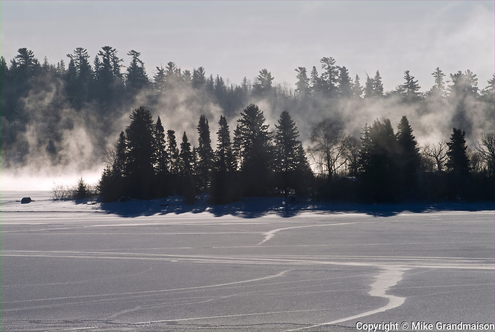 Fog rising  on frozen Lake of the Woods<br />