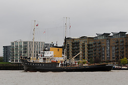 © Licensed to London News Pictures. 29/09/2016. LONDON, UK. Dutch Heritage tug, MV Holland passing Butlers Wharf after passing under Tower Bridge this morning. 122 year old Tower Bridge will close entirely to traffic for three months from 1 October and will include major maintenance to the bridge lifting mechanisms. During this time, the bascules, which are raised 800-900 times per year will be maintained as operable to river traffic. As well as large ships, Tower Bridge regularly opens to allow vessels with tall masts to pass under, such heritage tug, MV Holland who passed underneath this morning..  Photo credit: Vickie Flores/LNP