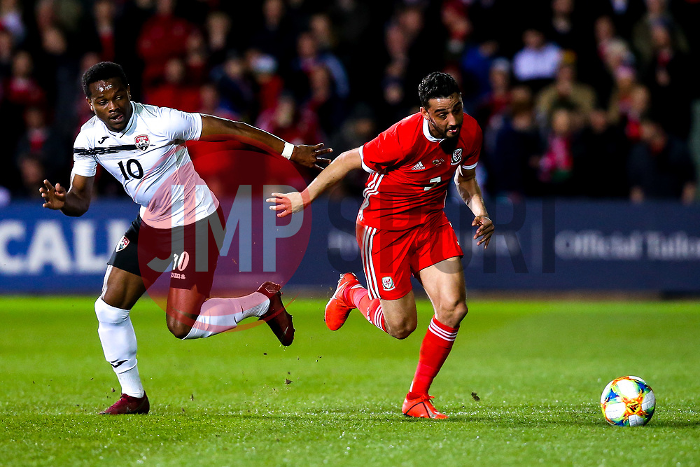 Neil Taylor of Wales takes on Duane Muckette of Trinidad and Tobago - Mandatory by-line: Robbie Stephenson/JMP - 20/03/2019 - FOOTBALL - The Racecourse Ground - Wrexham, United Kingdom - Wales v Trinidad and Tobago - International Challenge Match