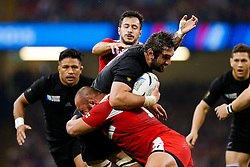 New Zealand Lock Samuel Whitelock is tackled by Georgia replacement Mikheil Nariashvili - Mandatory byline: Rogan Thomson/JMP - 07966 386802 - 02/10/2015 - RUGBY UNION - Millennium Stadium - Cardiff, Wales - New Zealand v Georgia - Rugby World Cup 2015 Pool C.