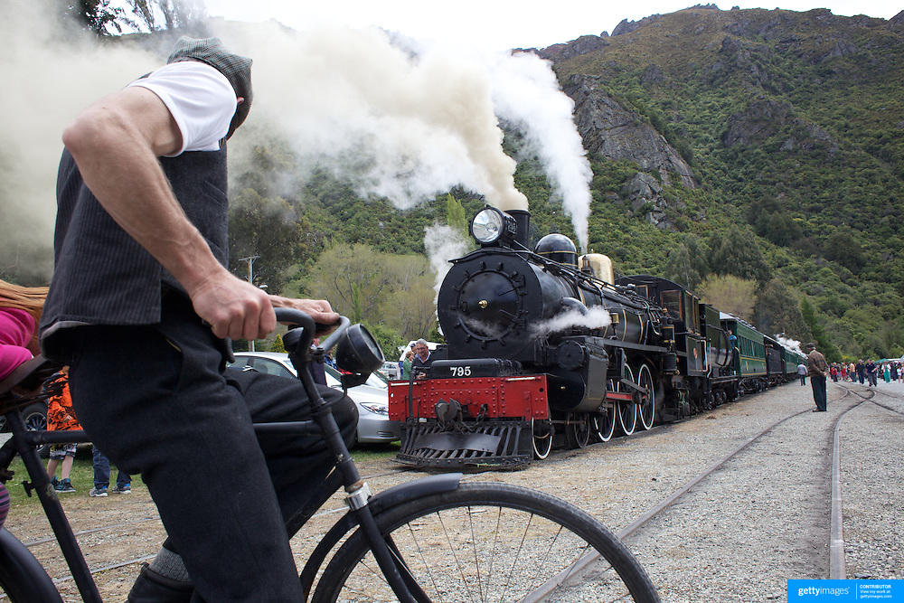 Robert Guyton on his vintage bike in front of the Kingston Flyer vintage steam train at Saturday's relaunch of the historic locomotives at Fairlight near Queenstown, Central Otago, New Zealand, 29th October 2011. Photo Tim Clayton...