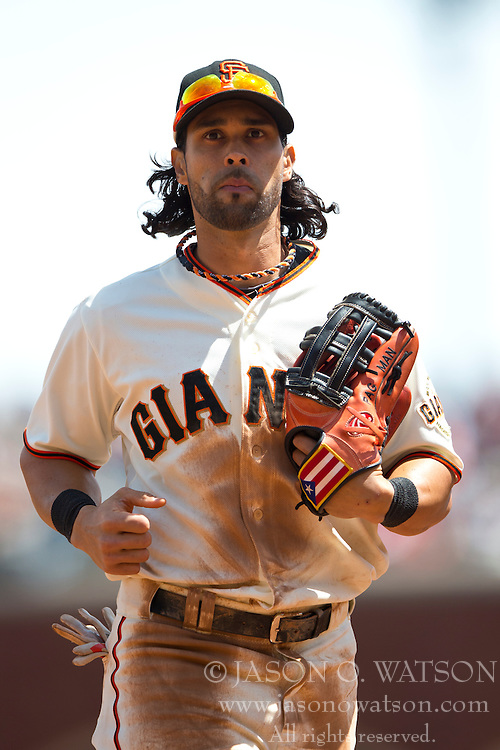 SAN FRANCISCO, CA - APRIL 26:  Angel Pagan #16 of the San Francisco Giants returns to the dugout during the third inning against the Cleveland Indians at AT&T Park on April 26, 2014 in San Francisco, California. The San Francisco Giants defeated the Cleveland Indians 5-3.  (Photo by Jason O. Watson/Getty Images) *** Local Caption *** Angel Pagan