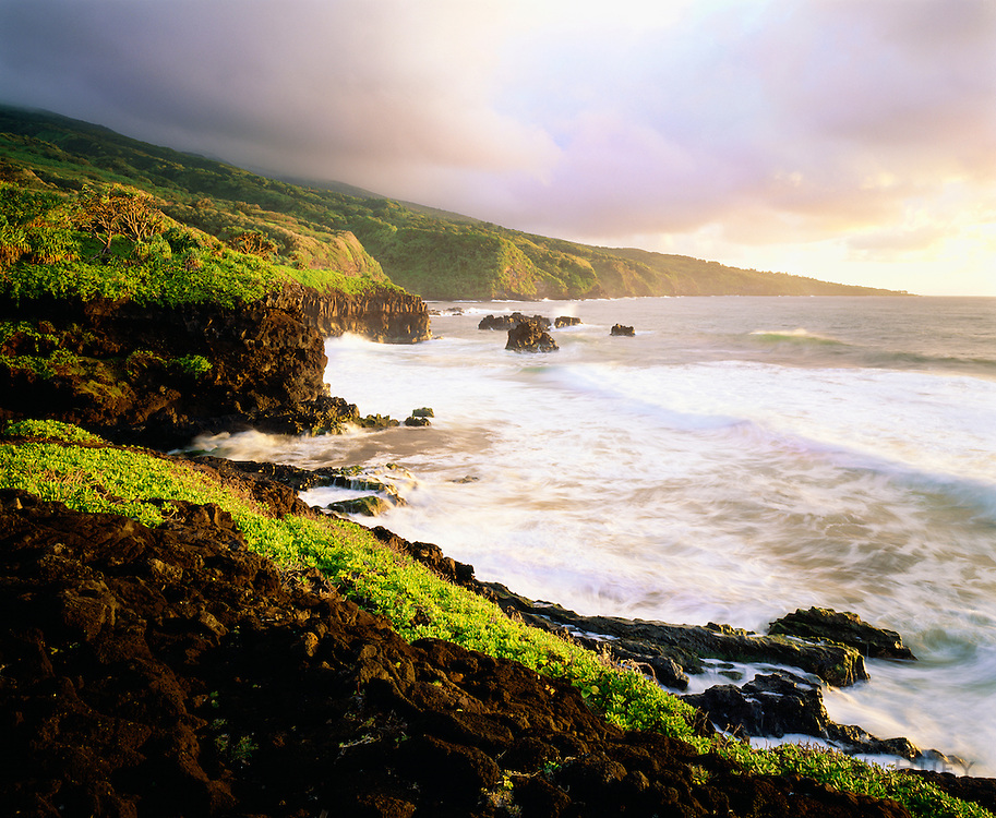 0803-1001C ~ Copyright: George H.H. Huey ~ The Pacific Ocean and the coast at Kipahulu at sunrise.  [This is the area where Palikea Stream flows through Oheo Gulch at enters the Pacific Ocean.]  Haleakala National Park, Maui, Hawaii.