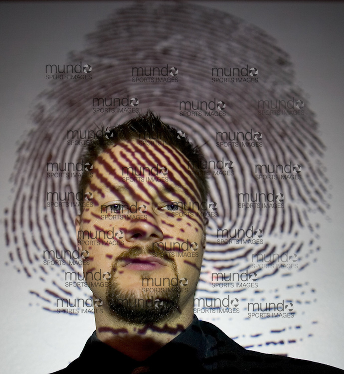 London: October 30, 2006 -JAMES QUIN  -  James Quin, senior research analyst with Info-Tech Research Group, seen here  with a fingerprint projected onto his face at the company's offices in London, Ontario, October 30, 2006, is uncomfortable with the error rate of biometrics and is uncertain how far it should go beyond fingerprint and iris recognition..Photo by GEOFF ROBINS for National Post.(For Financial Post Special Projects story by Danny Bradbury, Financial Post)