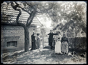 family posing in backyard with dogs France circa 1930s