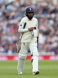 England's Adil Rashid walks of the field after being bowled for an lbw by India's Jasprit Bumrah (not in picture) during the test match at The Kia Oval, London.