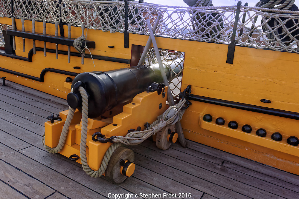 A cannon on deck of HMS Victory in Portsmouth, England. HMS Victory is a 104-gun ship of the line of the Royal Navy, launched in 1765. She was Lord Nelson's flagship at the Battle of Trafalgar in 1805.