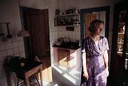Mette Bruhn, an artist, in her kitchen. Copenhagen, Denmark.