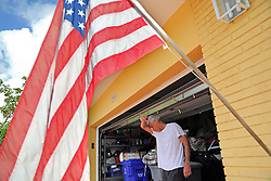 Bill Schumacher wipes the sweat from his eyes while securing his Lauderdale-By-The-Sea home in preparation for Hurricane Irma on Friday, Sept. 8, 2017. (Photo by Amy Beth Bennett /Sun Sentinel/TNS/Sipa USA)<br />SOUTH FLORIDA OUT; NO MAGS; NO SALES; NO INTERNET; NO TV