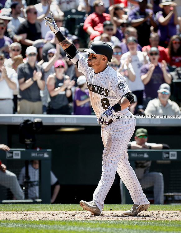 SHOT 5/28/17 1:12:13 PM - The Colorado Rockies Gerardo Parra #8 celebrates after hitting a three-run homer against the St. Louis Cardinals during their regular season MLB game at Coors Field in Denver, Co. The Rockies won the game 8-4. (Photo by Marc Piscotty / © 2017)