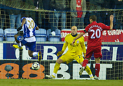WIGAN, ENGLAND - Monday, March 8, 2010: Liverpool's goalkeeper Pepe Reina is beaten by Wigan Athletic's Hugo Rodallega for the opening goal during the Premiership match at the DW Stadium. (Photo by David Rawcliffe/Propaganda)