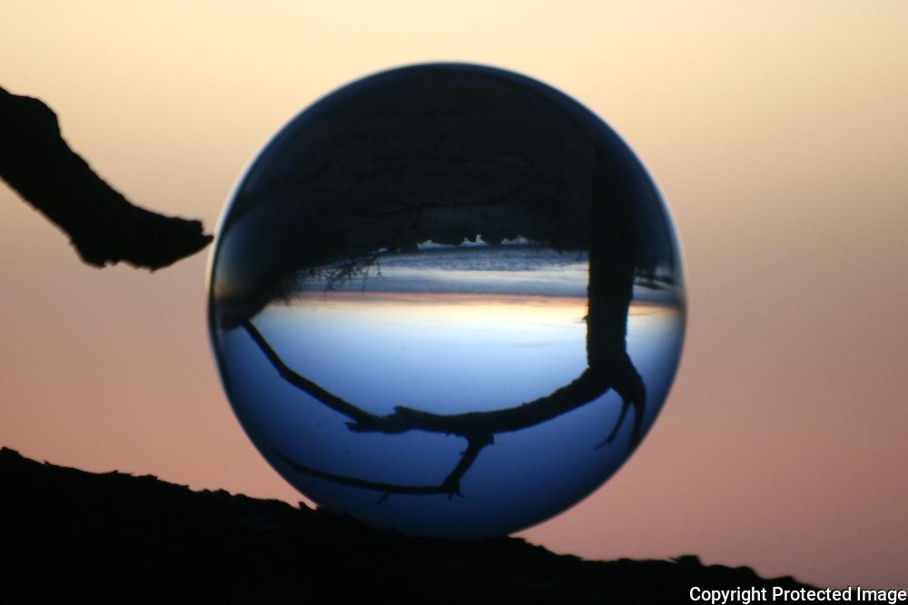 Beach sunrise through a crystal ball