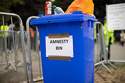 © Licensed to London News Pictures . 12/08/2018. Manchester , UK . Amnesty bin at the entrance to the park . The second day of the annual Caribbean Carnival in Alexandra Park in Moss Side , celebrating music , food and Afro-Caribbean culture . A nearby shooting overnight lead to at least ten people injured . Ten people are in hospital . Photo credit : Joel Goodman/LNP