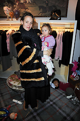 BAY GARNETT and her daughter SYLVIE at the Juicy Couture children's tea party in aid of Mothers 4 Children held at the Juicy Couture Store, Bruton Street, London on2nd December 2009.