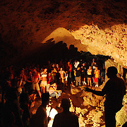 A guide takes tourists through the Cuevas de Bellamar, one of Cuba's largest cave systems, just outside the city of Matanzas, Cuba. There are more than 3,000 meters of galleries full of stalagmites and stalagmites in the system.