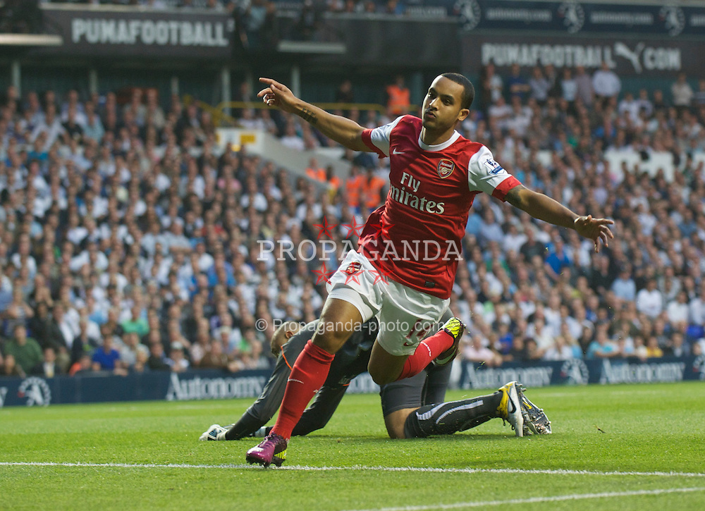 LONDON, ENGLAND - Wednesday, April 20, 2011: Arsenal's Theo Walcott celebrates scoring the first goal against Tottenham Hotspur during the Premiership match at White Hart Lane. (Photo by David Rawcliffe/Propaganda)