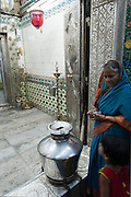 Woman at entrance to the inner shirne at the Nagoor Dargah.