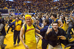 Jan 10, 2017; Morgantown, WV, USA; West Virginia Mountaineers students rush the floor after beating the Baylor Bears at WVU Coliseum. Mandatory Credit: Ben Queen-USA TODAY Sports