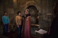 MARTAKERT, NAGORNO-KARABAKH - APRIL 18: Arkadina Sarukhanyan, 22, is baptised by Ter-Grigor Markosyan on April 18, 2015 at Gandzasar Monastery in Martakert, Nagorno-Karabakh. Since signing a ceasefire in a war with Azerbaijan in 1994, Nagorno-Karabakh, officially part of Azerbaijan, has functioned as a self-declared independent republic and de facto part of Armenia, with hostilities along the line of contact between Nagorno-Karabakh and Azerbaijan occasionally flaring up and causing casualties. (Photo by Brendan Hoffman/Getty Images) *** Local Caption *** Ter-Grigor Markosyan; Arkadina Sarukhanyan