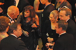Carm Cozza mingling with Yale President Rick Levin, his wife and others. Yale University Department of Athletics Blue Leadership Ball 2009. Formal Dinner at the Lanman Center, Presentation of Awards to Blue Leader Honorees and Speeches.