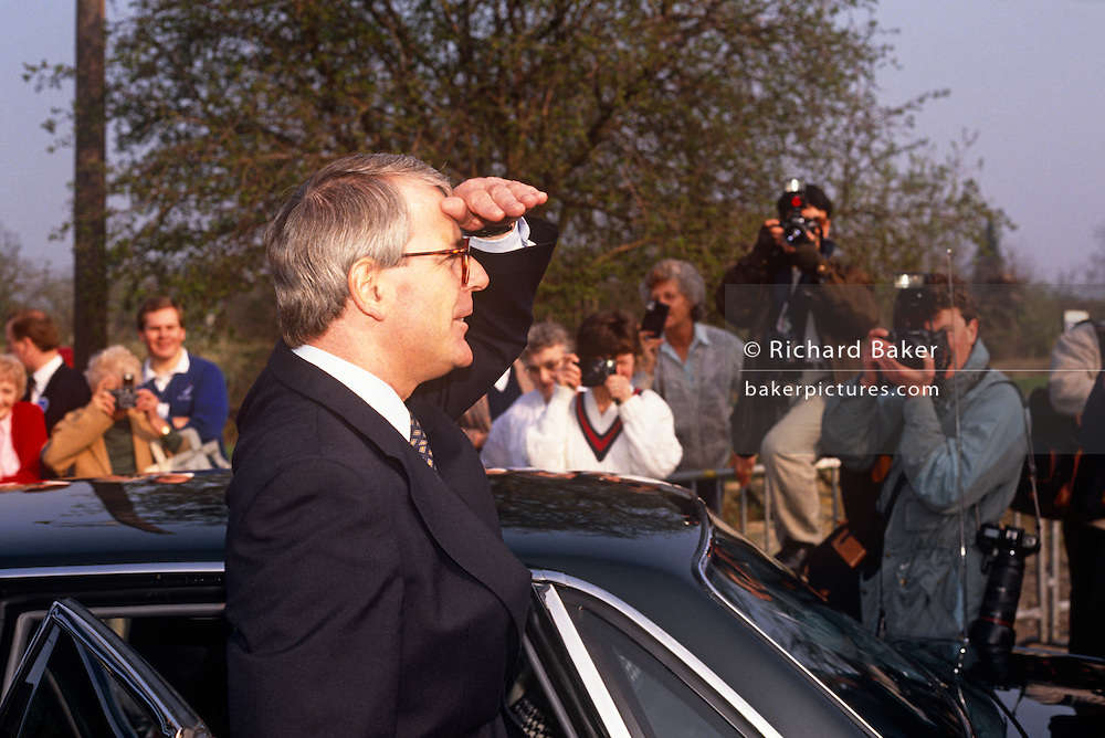 British Prime Minister, John Major looks into the distance while outside his constituency polling station while seeking re-election after replacing Margaret Thatcher, on 9th April 1992, Huntingdon, England. Major went on to win the election and was the fourth consecutive victory for the Conservative Party although it was its last outright win until 2015 after Labour's 1997 win for Tony Blair.