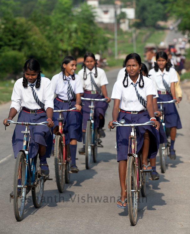 A group of school girls cycle through the streets of Selly, Jharkhand, 27 September, 2011. Photogrpaher: Prashanth Vishwanathan/Unicef