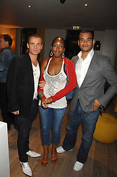 Left to right, JULIAN BENNET, TV presenter ANGELICA BELL and TV presenter MICHAEL UNDERWOOD at a party to celebrate the launch of a new fashion label 'Oli' at the Haymarket Hotel, 1 Suffolk Place, London on 4th July 2007.<br />