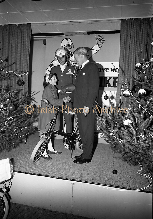 22/12/1965<br /> 12/22/1965<br /> 22 December 1965<br /> <br /> Mr. Sean Flanagan T.D.(Parliamentary Secretary to the Minister for Industry and Commerce presenting a bicycle to Miss Monica Harney of Dun Looghaire