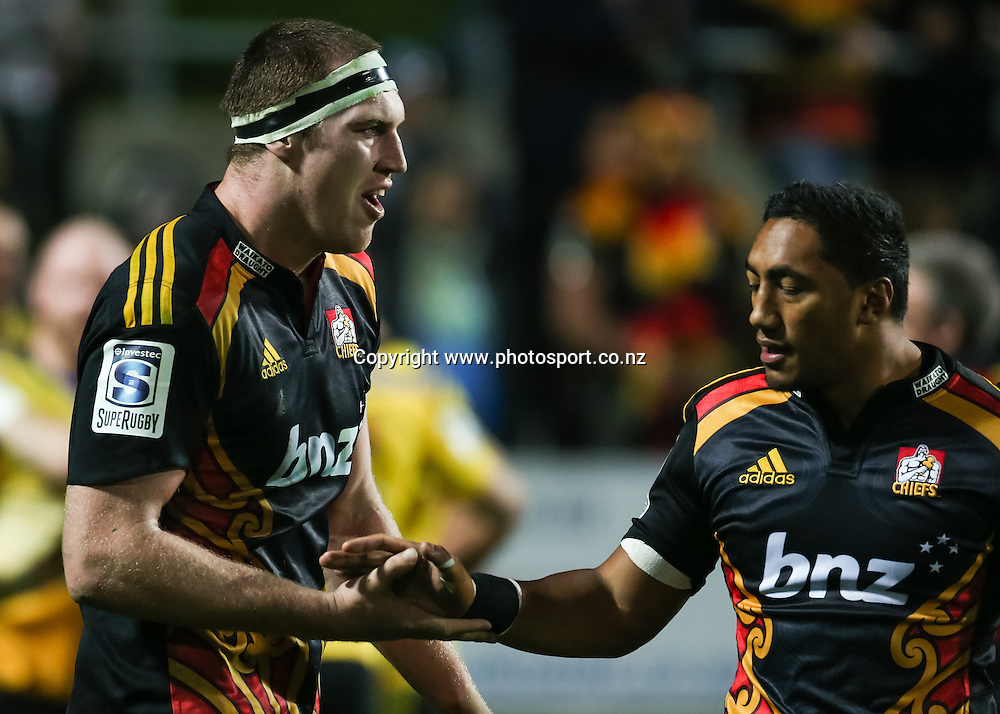 Chiefs' Bundee Aki congratulates Chiefs' Brodie Retallick on his try in the Super 15 Rugby match - Chiefs v Hurricanes at Waikato Stadium, Hamilton, New Zealand on Friday 4 July 2014.  Photo:  Bruce Lim / www.photosport.co.nz