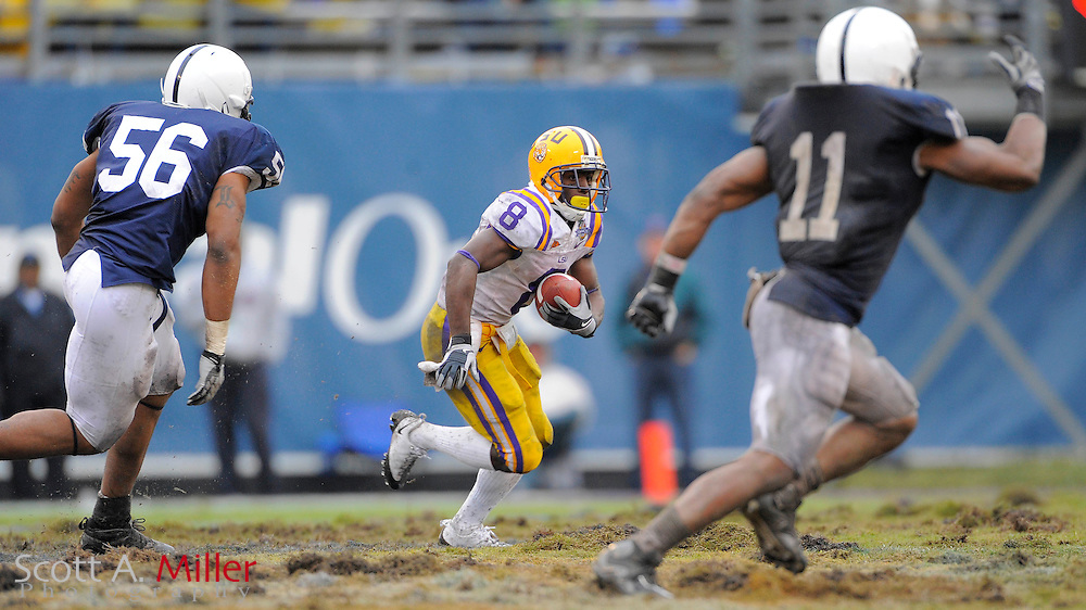 Jan. 1, 2010; Orlando, FL, USA; LSU Tigers running back Trindon Holliday (8) heads up field as he is chased by Penn State Nittany Lions defensive end Eric Latimore (56) and linebacker Navorro Bowman (11) in the 2009 Capital One Bowl at the Citrus Bowl. Penn State won the game 19-17. ©2010 Scott A. Miller