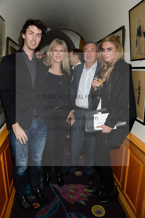 Left to right, GUY MASON, his parents NICK & NETTE MASON and JESS BECKER at an exhibition of the 50 best party pictures from Tatler from the past 50 years, held at Annabel's, Berkeley Square, London on 9th September 2013.