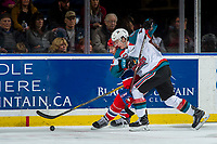 KELOWNA, CANADA - MARCH 3: Kole Lind #16 of the Kelowna Rockets checks a player of the Spokane Chiefs into the boards on March 3, 2018 at Prospera Place in Kelowna, British Columbia, Canada.  (Photo by Marissa Baecker/Shoot the Breeze)  *** Local Caption ***