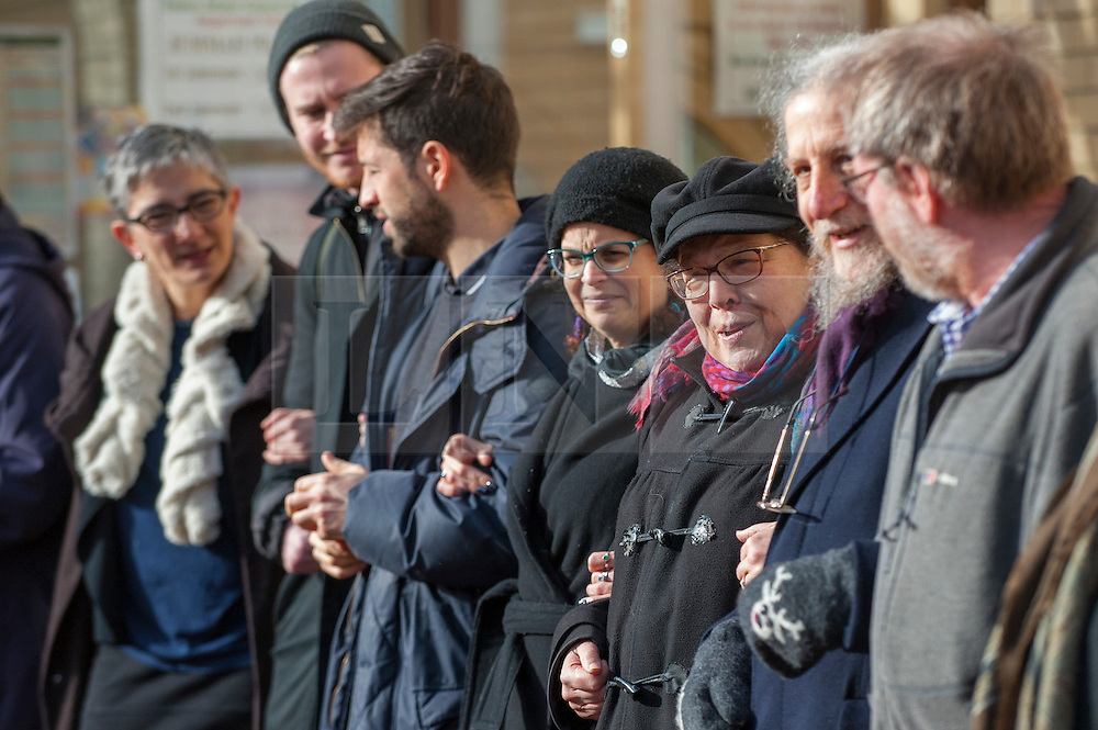 "© Licensed to London News Pictures. 03/02/2017. London, UK. A human circle of solidarity forms outside Wightman Road mosque in north London during Friday prayers in an event backed by a coalition of faith groups, including members of Reform Judaism, the Christian Muslim Forum and Faiths Forum for London.  The aim is to ""stand with our Muslim brothers and sisters at this time of international turbulence"", say the organisers. Photo credit : Stephen Chung/LNP"