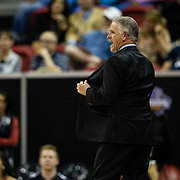 09 March 2018: San Diego State men's basketball takes on Nevada in the quarterfinal round of the Mountain West Conference Tournament. San Diego State Aztecs head coach Brian Dutcher uses his jacket to shield his play call in the first half. The Aztecs cruise past the Wolfpack 90-73 to move on to the Championship game tomorrow afternoon at 3pm.<br /> More game action at www.sdsuaztecphotos.com