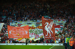 LIVERPOOL, ENGLAND - Monday, August 24, 2009: Liverpool supporters on the Spion Kop unfurl a large flag during the Premiership match at Anfield. (Photo by David Rawcliffe/Propaganda)