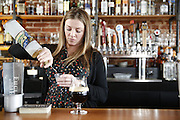 "SHOT 3/25/14 2:58:25 PM - Euclid Hall bar manager Jessica Cann of Denver, Co. prepares a ""Return of the Naughty Girl Scout"", a beer cocktail that mixes chocolate liquer, coffee liqueur, peppermint schnapps, and Left Hand Nitro Milk Stout beer $11. (Photo by Marc Piscotty / © 2014)"