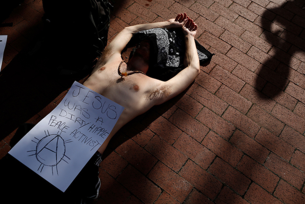 Protesters take a break between before a voter's suppression march during the Republican National Convention on August 28, 2012 in Tampa, Fla.