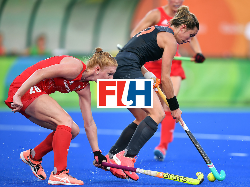 Britain's Nicola White (L) vies with Netherlands' Ellen Hoog during the women's Gold medal hockey Netherlands vs Britain match of the Rio 2016 Olympics Games at the Olympic Hockey Centre in Rio de Janeiro on August 19, 2016. / AFP / MANAN VATSYAYANA        (Photo credit should read MANAN VATSYAYANA/AFP/Getty Images)