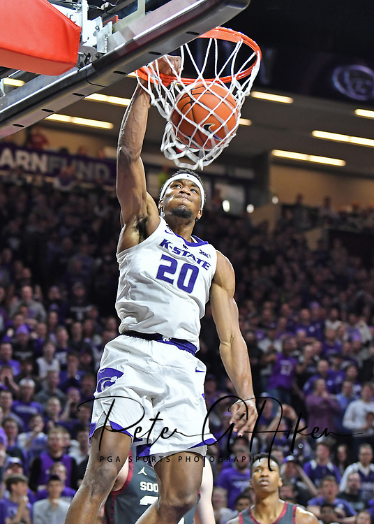 MANHATTAN, KS - MARCH 09:  Xavier Sneed #20 of the Kansas State Wildcats dunks the ball against the Oklahoma Sooners during the second half on March 9, 2019 at Bramlage Coliseum in Manhattan, Kansas.  (Photo by Peter G. Aiken/Getty Images) *** Local Caption *** Xavier Sneed